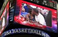"U.S. President Obama and first lady Michelle Obama are shown kissing on the ""Kiss Cam"" screen during a timeout in the Olympic basketball exhibition game between the U.S. and Brazil national men's teams in Washington"